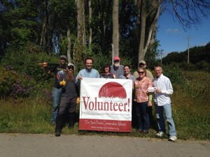 Volunteers and SPCA volunteer sign