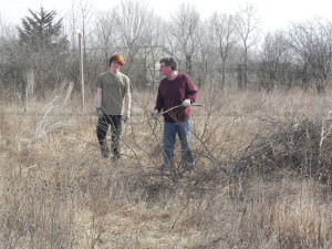 Father & son (Paul Anthony and Paul, Jr.) clear brush together